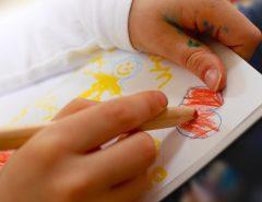 kids_drawing_a_logo_design